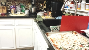 The worst thing about pizza night -- the lineup of pizzas waiting to go in the oven!